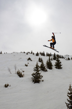 skier jumping: skier jumping over some trees