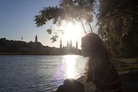 melancholy: woman looking a view of Zaragoza full of melancholy