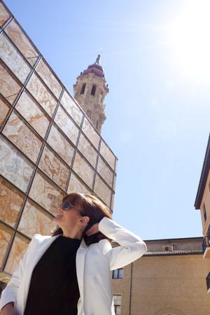 zaragoza: woman touching her hair in La Seo square, Zaragoza, Spain