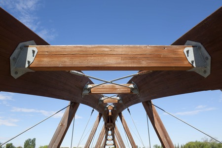 is cloudless: structure of a wooden bridge in a cloudless sky