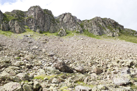 Avalanche of stones in a mountainside in a sunny day in summer