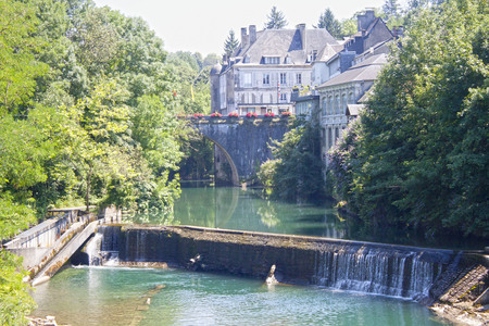 marie: Lake with a waterfall in Oloron Saint Marie, France