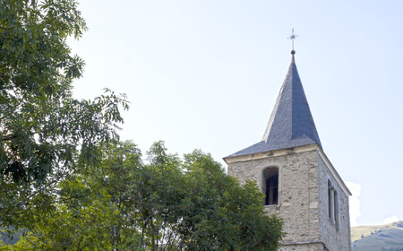 saint jacques: Saint Jacques church in Saint Lary near a tree, France Stock Photo