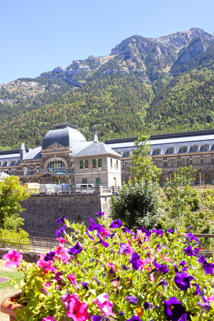 train station in front of some purple flowers, Canfranc, Spain