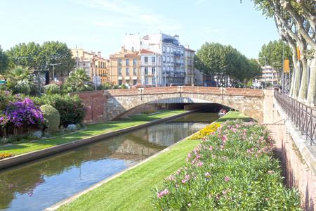 Tet river and a bridge in Perpignan between some buildings, France Stock fotó
