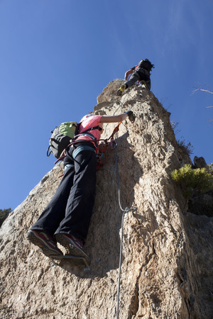 two mountaineers doing a via ferrata in Andorra