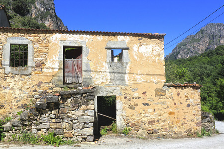 Abandoned stoned house in a village in Asturias, Spain