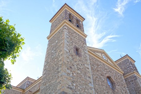 stoned church of Potes in a cloudless day, San Vicente in Spain