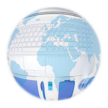 globe over a laptop and blue things to use in an office Stock Photo