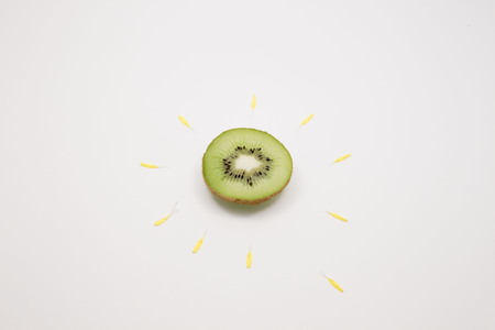kiwi with petals surrounded of it like a flower Stock Photo