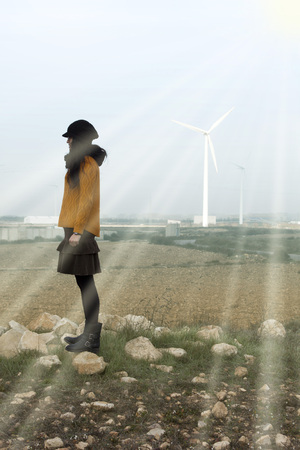 girl close to mills wind in a sunny day 스톡 콘텐츠