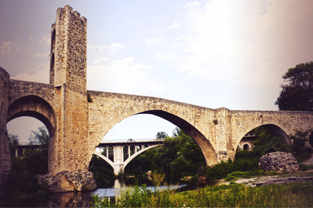 bridge and a tower over a river and trees, Spain 스톡 콘텐츠
