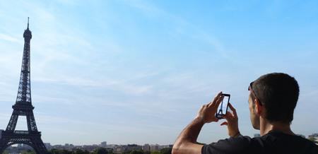 Man taking a photograph of Eiffel tower in Paris