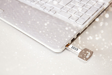 key pendrive in the usb port with lights 스톡 콘텐츠