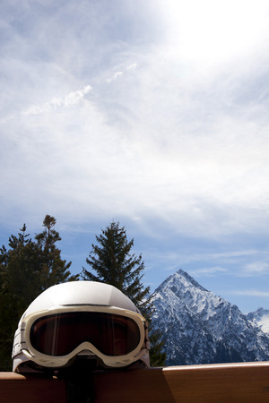 helmet in front of a landscape with trees and mountains