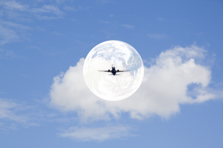 Plane in an air bubble flying in the sky