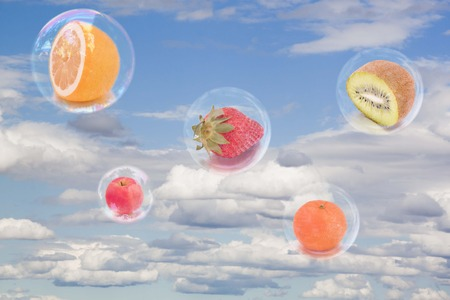 Five fruits inside five bubbles in the sky flying 스톡 콘텐츠
