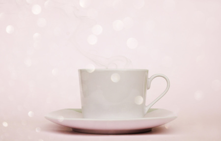 cup of coffee in the morning with bokeh in pink