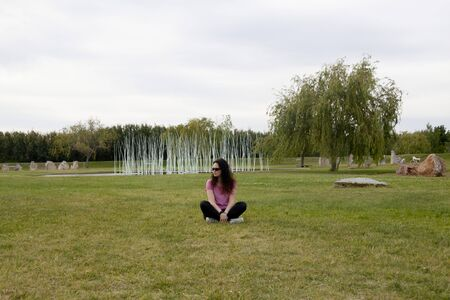 woman sit in a park thinking about things