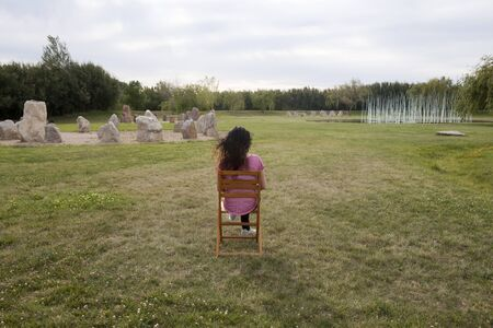 woman in a chair doing something