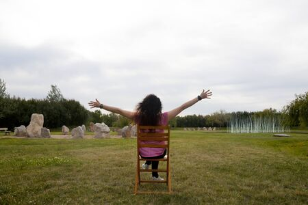 woman in a chair celebrating something 스톡 콘텐츠