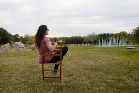 woman in a chair thinking about something