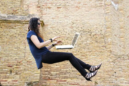 woman flying while working with a computer