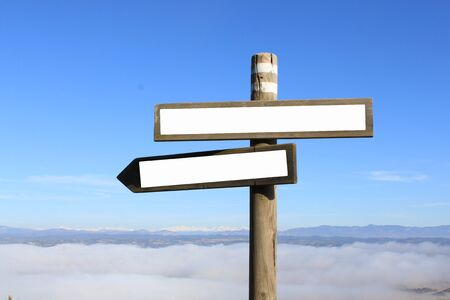 two signs indicating the way to anywhere