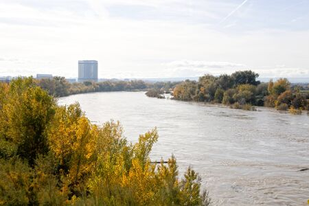 panoramic of Torre del agua in Zaragoza behind the Ebro river in a sunny day, Spain