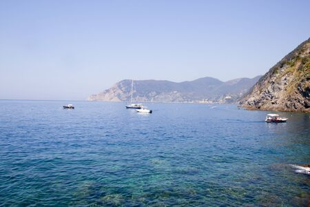 The sea with some boats in Monterosso, Italy