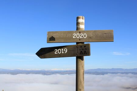 two signs indicating the way to 2019 or 2020 year Stock fotó