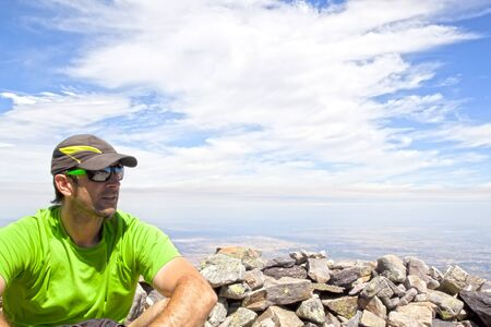 Man with a cap over a hill with stones in Spain
