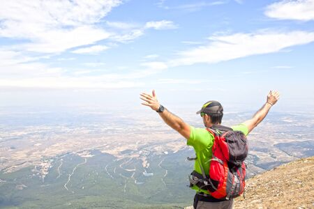 Man on the Moncayo mountain enjoying the view in summer