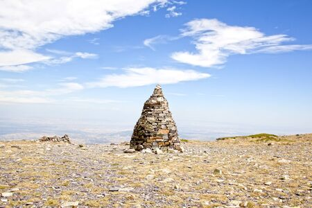 Pillar of stones over the Moncayo mountain with a blue sky in Spain