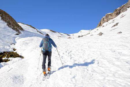 man making touring ski in Pyrenees mountains in France