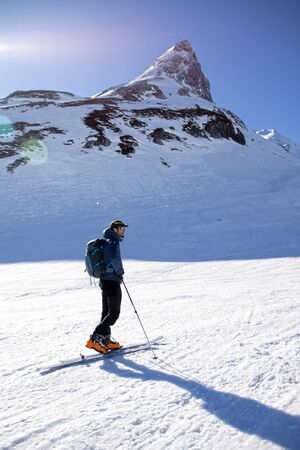 man waiting in the mountains in a sunny day while skiing Stock fotó