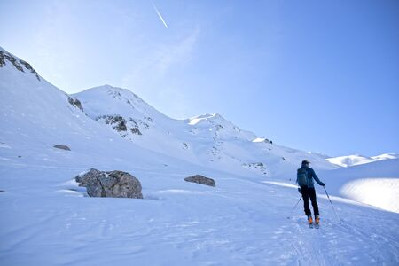 man making touring ski in a sunny day surrounded of mountains in Pyrenees Stock fotó