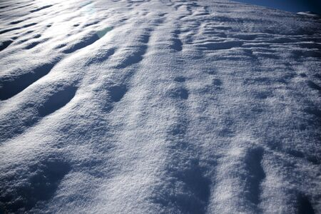 snow surface in the night with waves in winter