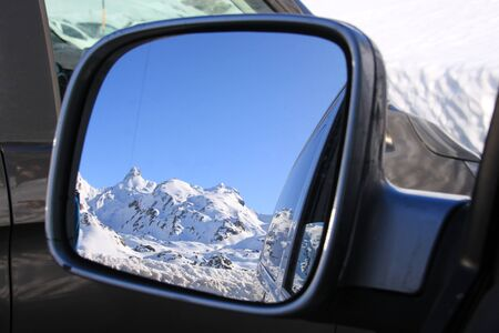 rear mirror with a snowed mountain reflected in it Stock fotó