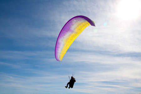 man flying free in a blue sky in a sunny day