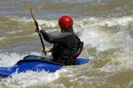 kayaker: Kayaker riding the waves at an urban whitewater park