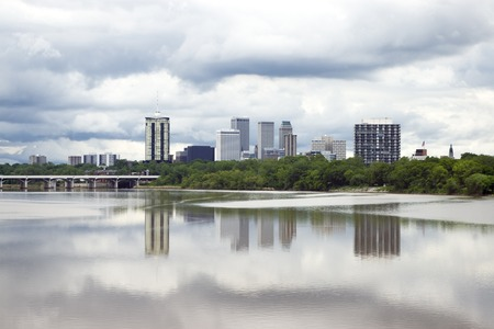 mirrored: Stormy skyline of the city of Tulsa just before a severe spring storm, mirrored by its reflection in the Arkansas River.