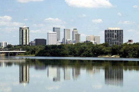 oklahoma city: Skyline view of the city of Tulsa, Oklahoma with buildings reflected in the Arkansas River.