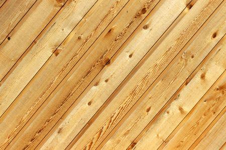 knothole: Diagonal wood siding background with knotholes and wood grain. Stock Photo
