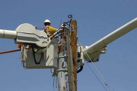 utility pole: Linemen Replacing Old Utility Pole Stock Photo