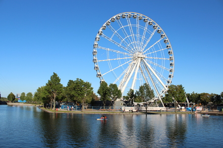 Montreal Ferris Wheel. A view on the Montreal Ferris Wheel on an artificial island at the Old Port Stock Photo