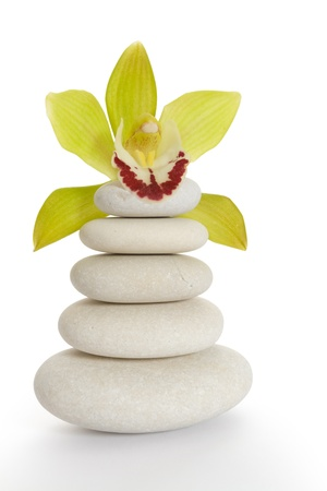 Pyramid of stones with orchid above them Stock Photo