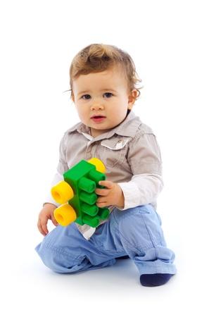Studio shot of baby boy looking at camera
