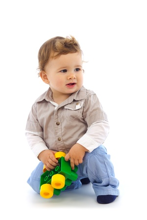 Photo of baby boy with toy in his hand Stock Photo