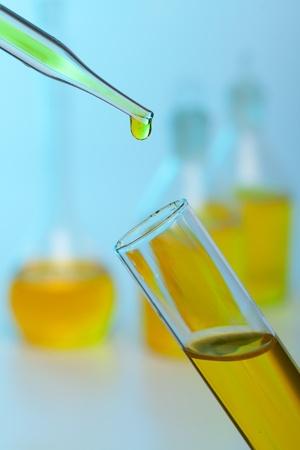 Photo of bio fuel drop on blue background Stock Photo